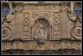 La iglesia de San Pedro, en Ayerbe, es una construcción de sillería, sillarejo, ladrillo y tapial que ofrece obra de varias épocas. Fachada con decoración programada, toda ella es de piedra y concentra su decoración en la portada. La portada está protegida, en el interior, por un biombo de madera, de tableros lisos.